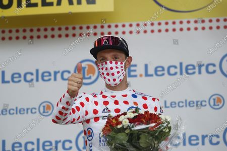 Canadian rider Michael Woods of the Israel Start-Up Nation team celebrates being awarded the Polka-Dot Jersey after the 14th stage of the Tour de France 2021 over 183.7 km from Carcassonne to Quillan, France, 10 July 2021.