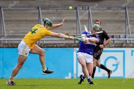 Stock Picture of Antrim vs Laois. Laois' Willie Dunphy scores a point despite the efforts of Stephen Rooney of Antrim