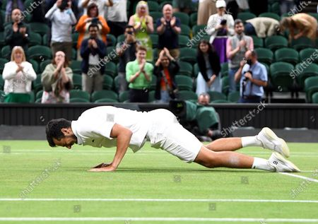 Mate Pavic of Croatia celebrates after winning his men's doubles final with compatriot Nikola Mektic against Marcel Granollers of Spain and Horacio Zeballos of Argentina at the Wimbledon Championships in Wimbledon, Britain, 10 July 2021.