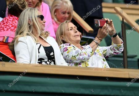 Former tennis player Martina Navratilova (R) takes a selfie during the women's final between Ashleigh Barty of Australia and Karolina Pliskova of Czech Republic at the Wimbledon Championships, Wimbledon, Britain 10 July 2021.