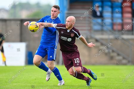 Andrew McDonald (#4) of Peterhead FC and Liam Boyce (#10) of Heart of Midlothian FC tussle for the ball during the Premier Sports Scottish League Cup match between Peterhead FC and Heart of Midlothian FC at Balmoor, Peterhead