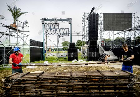 Workers dismantle a stage after the festival 7th Sunday: Live Again! was canceled on short notice in Erp, The Netherlands, 10 July 2021. Dutch Outgoing Prime Minister Mark Rutte and health minister Hugo de Jonge announced that one-day events may receive fewer visitors, who must also all be seated. Many festivals are therefore canceled at the last minute.