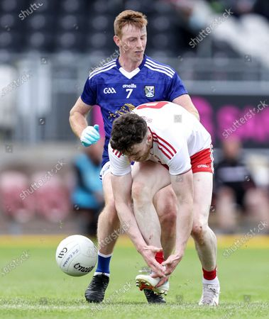 Tyrone vs Cavan. Tyrone's Michael O'Neill and Jason McLoughlin of Cavan