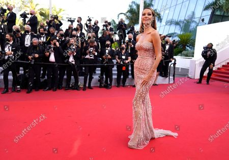 Maeva Coucke poses for photographers upon arrival at the premiere of the film 'Peaceful' at the 74th international film festival, Cannes, southern France