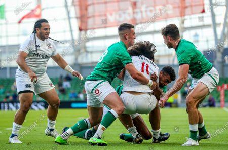 Ireland vs USA. USA's Mika Kruse is tackled by James Hume, Robert Baloucoune and Hugo Keenan of Ireland