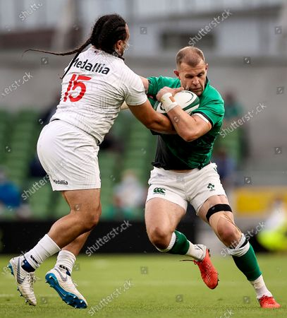Ireland vs USA. Ireland's Will Addison comes up against Mike Te'o of USA