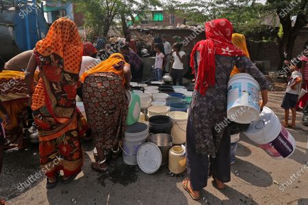 Residents collect drinking water from a Nagar Nigam tanker due to water crisis at Jhalana Doongri Slum area in Jaipur ,Rajasthan, India,  Saturday, July 10,2021.