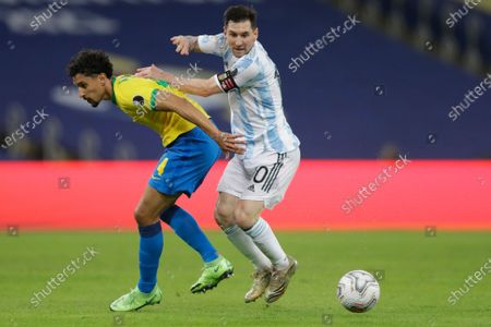 Argentina's Lionel Messi, right, and Brazil's Marquinhos battle for the ball during the Copa America final soccer match at the Maracana stadium in Rio de Janeiro, Brazil