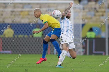 Argentina's Nicolas Otamendi, right, and Brazil's Richarlison battle for the ball during the Copa America final soccer match at the Maracana stadium in Rio de Janeiro, Brazil