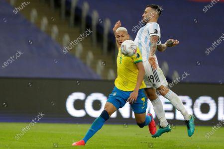 Brazil's Richarlison, left, and Argentina's Nicolas Otamendi battle for the ball during the Copa America final soccer match at the Maracana stadium in Rio de Janeiro, Brazil