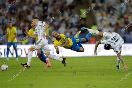 Brazil's Neymar, center, and Argentina's Nicolas Otamendi, right, fall to the ground during the Copa America final soccer match at the Maracana stadium in Rio de Janeiro, Brazil