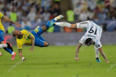 Stock Photo of Brazil's Neymar, left, and Argentina's Nicolas Otamendi fall to the ground during the Copa America final soccer match at the Maracana stadium in Rio de Janeiro, Brazil