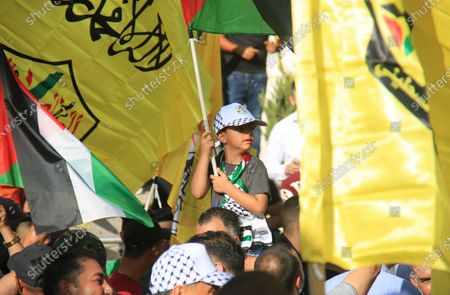 Palestinian supporters of Fatah rally in support of president Mahmud Abbas in the occupied West Bank city of Ramallah, on July 10, 2021.