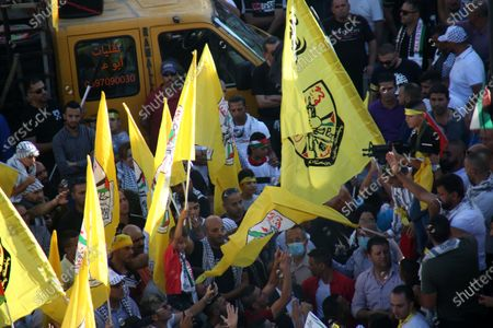 Stock Image of Palestinian supporters of Fatah rally in support of president Mahmud Abbas in the occupied West Bank city of Ramallah, on July 10, 2021.