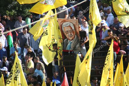 Stock Picture of Palestinian supporters of Fatah rally in support of president Mahmud Abbas in the occupied West Bank city of Ramallah, on July 10, 2021.