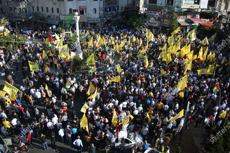 Stock Photo of Palestinian supporters of Fatah rally in support of president Mahmud Abbas in the occupied West Bank city of Ramallah, on July 10, 2021.