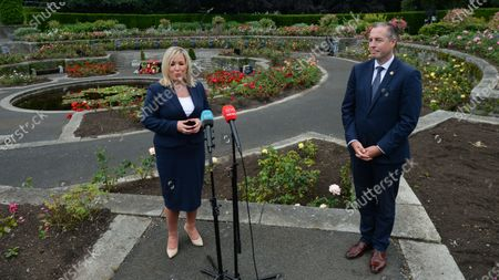 Stock Photo of Michelle O'Neill, Northern Ireland's Deputy First Minister and Paul Givan, Northern Ireland's First Minister, speak to the media, after they attended the ceremony marking the 105th anniversary of the Battle of the Somme, in the Irish National War Memorial Gardens, at Islandbridge in Dublin.On Saturday, 10 July 2021, in Dublin, Ireland