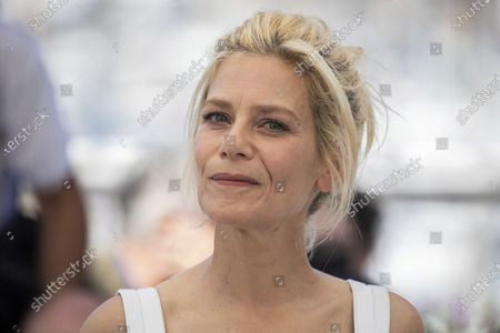 Marina Fois poses for photographers at the photo call for the film 'The Divide' at the 74th international film festival, Cannes, southern France