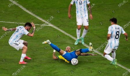Brazil's Neymar falls challenged by Argentina's Rodrigo De Paul and Marcos Acuna during the Copa America final soccer match at Maracana stadium in Rio de Janeiro, Brazil