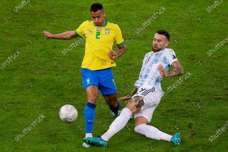 Brazil's Danilo, left, and Argentina's Nicolas Otamendi battle for the ball during the Copa America final soccer match at Maracana stadium in Rio de Janeiro, Brazil