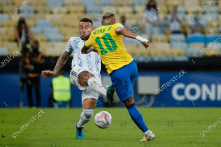 Stock Picture of Argentina's Nicolas Otamendi, left, and Brazil's Neymar battle for the ball during the Copa America final soccer match at the Maracana stadium in Rio de Janeiro, Brazil