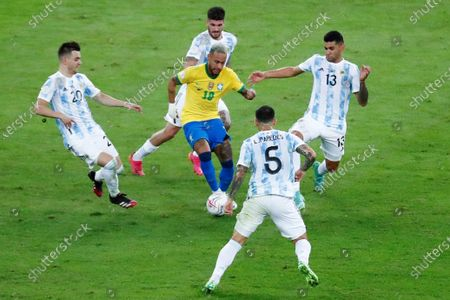 Argentina's Giovani Lo Celso (L) and Cristian Romero (R) in action against Brazil's Neymar Jr, during the Copa America 2021 final between Argentina and Brazil at the Maracana Stadium in Rio de Janeiro, Brazil, 10 July 2021.