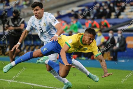 Argentina's Marcos Acuna (L) in action against Brazil's Danilo, during the Copa America 2021 final between Argentina and Brazil at the Maracana Stadium in Rio de Janeiro, Brazil, 10 July 2021.