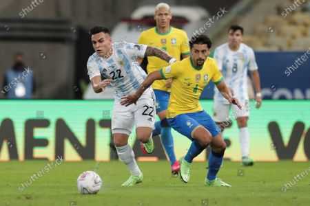 Lautaro Martinez (L) of Argentina disputes the ball with Marquinhos of Brazil, during the Copa America 2021 final between Argentina and Brazil at the Maracana Stadium in Rio de Janeiro, Brazil, 10 July 2021.