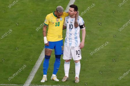 Argentina's Lionel Messi (R) greets Brazil's Neymar Jr, during the Copa America 2021 final between Argentina and Brazil at the Maracana Stadium in Rio de Janeiro, Brazil, 10 July 2021.