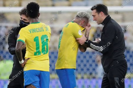 Argentina's coach Lionel Scaloni (R) cheers up Brazil's Neymar Jr after the Copa America 2021 final between Argentina and Brazil at the Maracana Stadium in Rio de Janeiro, Brazil, 10 July 2021.