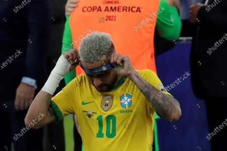 Brazil's Neymar Jr takes off his runner-up medal after the defeat against Argentina after the Copa America 2021 final between Argentina and Brazil at the Maracana Stadium in Rio de Janeiro, Brazil, 10 July 2021.