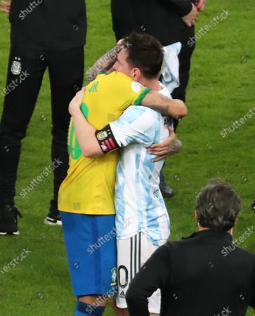 Stock Photo of Lionel Messi of Argentina (R) hugs Neymar Jr of Brazil (L) after their Copa America final soccer match at Maracana Stadium in Rio de Janeiro, Brazil, 10 July 2021. Argentina beat Brazil 1-0 to win Copa America.