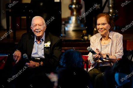 Former President Jimmy Carter and his wife former First Lady Rosalynn Carter sit together during a reception to celebrate their 75th anniversary, in Plains, Ga