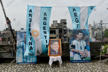 A photo frame decorated with a garland of an Argentine football legend Diego Maradona in a rooftop ahead of the Copa America final match between Argentina and Brazil, Kolkata, India, 10 July, 2021.