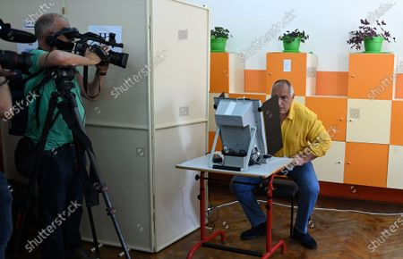 Bulgarian former prime minister Boyko Borissov, the leader of the GERB party, casts his vote at a polling station during the country's parliamentary elections in Sofia, Bulgaria, 11 July 2021. Until the polls close at 8:00 p.m. (5:00 p.m. GMT), voters will be able to choose between 23 parties and alliances, seven fewer than the previous 04 April legislatures, to form the new 240-seat Parliament. Victory will be contested by the conservatives of the Bulgarian Citizens for European Development (GERB), led by former Prime Minister Boyko Borissov, and by There Is Such a People, a political party recently founded by singer and television host Slavi Trifonov.
