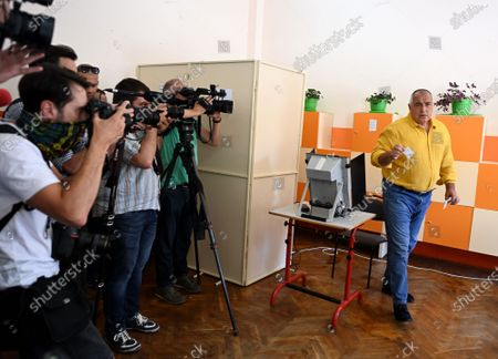 Bulgarian former prime minister Boyko Borissov (R), the leader of the GERB party, casts his vote at a polling station during the country's parliamentary elections in Sofia, Bulgaria, 11 July 2021. Until the polls close at 8:00 p.m. (5:00 p.m. GMT), voters will be able to choose between 23 parties and alliances, seven fewer than the previous 04 April legislatures, to form the new 240-seat Parliament. Victory will be contested by the conservatives of the Bulgarian Citizens for European Development (GERB), led by former Prime Minister Boyko Borissov, and by There Is Such a People, a political party recently founded by singer and television host Slavi Trifonov.