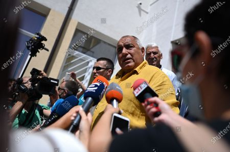 Bulgarian former prime minister Boyko Borissov (C), the leader of the GERB party, speaks to members of the media outside a polling station during the country's parliamentary elections in Sofia, Bulgaria, 11 July 2021. Until the polls close at 8:00 p.m. (5:00 p.m. GMT), voters will be able to choose between 23 parties and alliances, seven fewer than the previous 04 April legislatures, to form the new 240-seat Parliament. Victory will be contested by the conservatives of the Bulgarian Citizens for European Development (GERB), led by former Prime Minister Boyko Borissov, and by There Is Such a People, a political party recently founded by singer and television host Slavi Trifonov.
