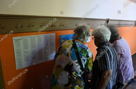 Elderly women wait for their turn to vote at a polling station during the country's parliamentary elections in Sofia, Bulgaria, 11 July 2021. Until the polls close at 8:00 p.m. (5:00 p.m. GMT), voters will be able to choose between 23 parties and alliances, seven fewer than the previous 04 April legislatures, to form the new 240-seat Parliament. Victory will be contested by the conservatives of the Bulgarian Citizens for European Development (GERB), led by former Prime Minister Boyko Borissov, and by There Is Such a People, a political party recently founded by singer and television host Slavi Trifonov.