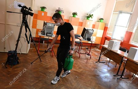A man sprays disinfectant to combat the spreading of the coronavirus disease (COVID-19) pandemic at a polling station during the country's parliamentary elections in Sofia, Bulgaria, 11 July 2021. Until the polls close at 8:00 p.m. (5:00 p.m. GMT), voters will be able to choose between 23 parties and alliances, seven fewer than the previous 04 April legislatures, to form the new 240-seat Parliament. Victory will be contested by the conservatives of the Bulgarian Citizens for European Development (GERB), led by former Prime Minister Boyko Borissov, and by There Is Such a People, a political party recently founded by singer and television host Slavi Trifonov.