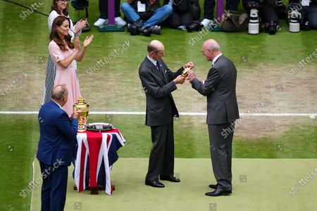 The Duke of Kent is presented with a replica trophy