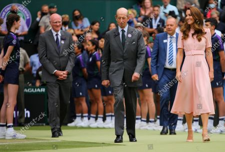 HRH The Duke of Kent walks on with HRH The Duchess of Cambridge following the Final