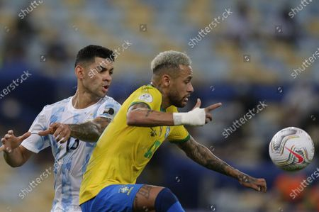 Stock Picture of (210711) - RIO DE JANEIRO, July 11, 2021 (Xinhua) - Argentina's Cristian Romero (L) vies with Brazil's Neymar during the 2021 Copa America football tournament final match in Rio de Janeiro, Brazil, on July 10, 2021.