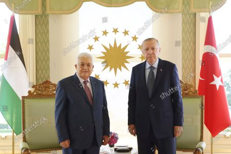 Turkey's President Recep Tayyip Erdogan, right, poses for photographs with Mahmoud Abbas, the President of the Palestinian Authority, prior to their meeting in Istanbul