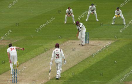 Charlie Thurston of Northamptonshire plays a shot off the bowling of Michael Hogan of Glamorgan