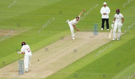 Michael Hogan of Glamorgan bowls to Ricardo Vasconcelos of Northamptonshire