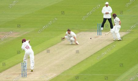 Michael Hogan of Glamorgan attempts to stop the ball from a shot played by Emilio Gay of Northamptonshire