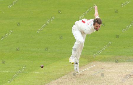 Michael Hogan of Glamorgan bowls to Emilio Gay of Northamptonshire