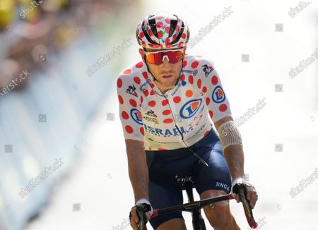 Michael Woods of Canada crosses the finish line after losing his best climber's dotted jersey to Netherland's Wouter Poels during the fifteenth stage of the Tour de France cycling race over 191.3 kilometers (118.9 miles) with start in Ceret and finish in Andorra-la-Vella, Andorra