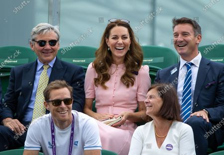 Britain's Catherine, The Duchess of Cambridge, Patron of the All England Lawn Tennis Club on No.3 Court with her father Michael Middleton (L) and Scott Lloyd LTA Chief Executive (R), during the Gordon Reid of Britain and Joachim Gerard of Belgium match in the final of the Gentlemen's Wheelchair Singles at TheThe Wimbledon Championships, in Wimbledon, Britain, 11 July 2021.