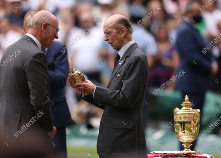 Britain's Prince Edward, Duke of Kent (R) participates in the trophy ceremony after the men's final match between Novak Djokovic of Serbia and Matteo Berrettini of Italy at the Wimbledon Championships, Wimbledon, Britain 11 July 2021. Djokovic won 3-1.